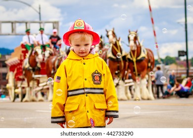 Portland, Oregon, USA - June 11, 2016: Small child dressed as Firefighter in the Grand Floral Parade during Portland Rose Festival 2016.
