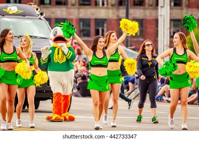 Portland, Oregon, USA - June 11, 2016: University of Oregon Duck Truck, Pep Band, Cheerleaders and Duck in the Grand Floral Parade during Portland Rose Festival 2016.