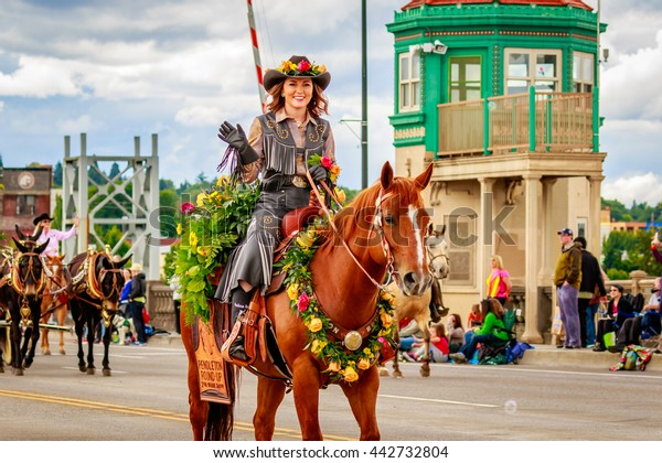 Portland, Oregon, USA - June 11, 2016: Pendleton Round-Up Court in the Grand Floral Parade during Portland Rose Festival 2016.