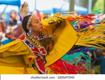 Portland, Oregon USA - June 14, 2014: A closeup of a dancing Native American Woman with her eyes closed at the annual Delta Park Pow Wow in Portland, Oregon.