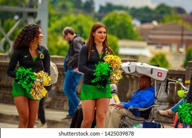 Portland, Oregon, USA - June 8, 2019: University or Oregon cheerleaders in the Grand Floral Parade, during Portland Rose Festival 2019.