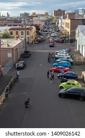 Portland, Oregon / USA - May 26, 2019: Cars line up along SE 2nd Avenue as part of The Red Door Meetup, an ongoing weekly tradition amongst car enthusiasts