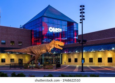 Portland, Oregon, USA - May 4th, 2021: Illuminated building of OMSI (Oregon Museum of Science  Industry)  at dusk