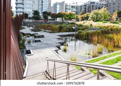 Portland, Oregon / USA - October 2017: Tanner Springs Park is a remediated wetland and naturalized public space designed by Atelier Dreiseitl in the Pearl District.