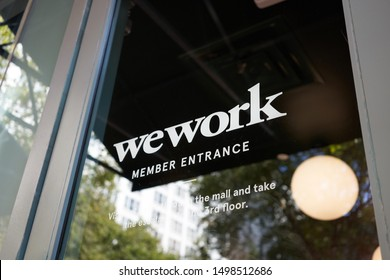 Portland, Oregon, USA - Sep 6, 2019: The WeWork logo at the entrance to a WeWork co-working space location in Pioneer Place in downtown Portland.