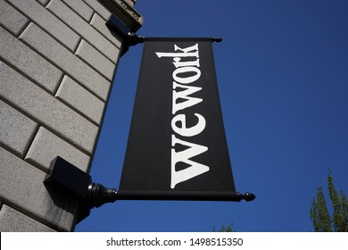Portland, Oregon, USA - Sep 6, 2019: The WeWork banner outside a WeWork co-working space location in US Custom House in downtown Portland's Pearl District.