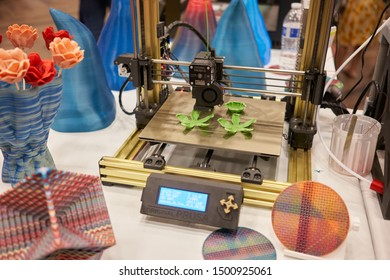 Portland, Oregon, USA - Sep 8, 2019: A Prusa i3 3D printer manufactured by Czech company Prusa Research is seen printing flowers at the Portland Mini Maker Faire.