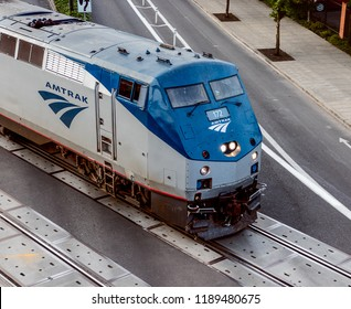 Portland, Oregon / USA - September 18 2018: An Amtrak Train crossing NW Naito Parkway on its way toward the Steel Bridge