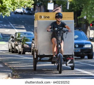 Portland, Oregon, USA - September 20, 2014:  B Line worker provides peddle power to a Portland, Oregon, urban eco-delivery business in the streets of downtown.