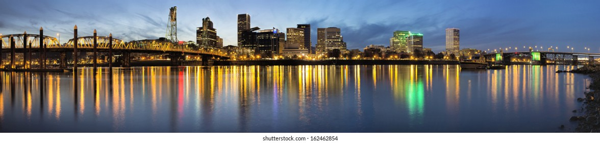 Portland Oregon Waterfront City Downtown and Bridges Along Willamette River from Eastbank Esplanade at Evening Blue Hour