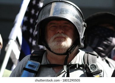 """Portland, Oregon/United States-August 22, 2020: Conservative people from the far right movement, Proud Boys, and Boogaloo join for a """"Back the Blue"""" rally."""