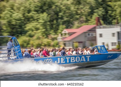 Portland, Oregon,USA - July 26, 2009:  Willamette jetboat speeds along the river carring people on a thrill ride in Portland, Oregon.
