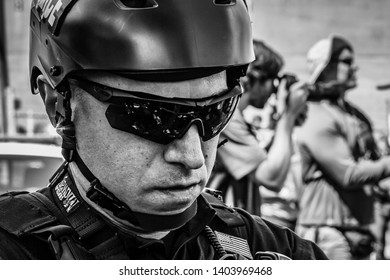 Portland, Oregon/USA - May 1, 2019: A Homeland Security officer confronts anti-ICE protesters.