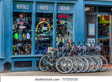 Portland, Oregon,USA - October 8, 2016: A bike shop store front with multiple bikes lined up on the sidewalk in downtown Portland, Oregon