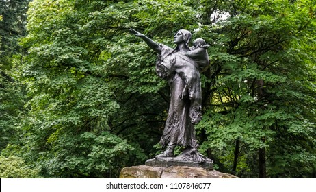 Portland, Oregon/USA -  September 18, 2016:  Statue of Sacajawea with Jean-Baptiste in Washington Park.    This photo was taken on a rainy day.