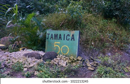 Portland Parish, Jamaica - January 1, 2014: Green Jamaica 50 sign by the side of the B1 road in the Blue Mountains region of the Portland Parish, Jamaica on New Years Day morning 2014.