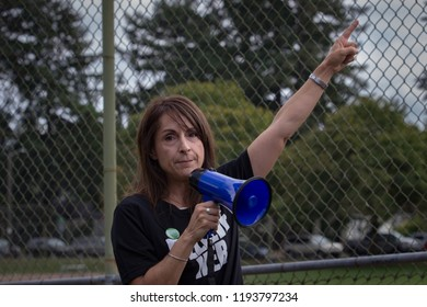 Portland, OR – September 30, 2018: Hundreds gathered at Rose City Park in protest against the nomination of Brett Kavanaugh for the U.S. Supreme Court, and in support of Dr. Christine Blase Ford.