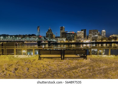 Portland Skyline View from Eastbank Esplanade during evening blue hour on a cold winter night