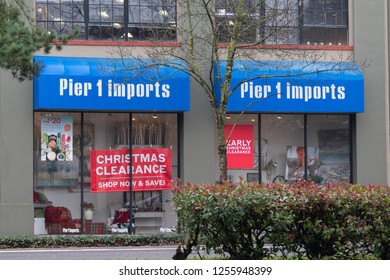 Portland, OR / USA - December 10 2018: Pier1 imports store with big Christmas clearance sign in the window.