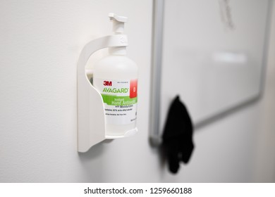 Portland, OR / USA - December 14 2018:  Instant hand antiseptic with moisturizer by 3M hanging on a wall in the office