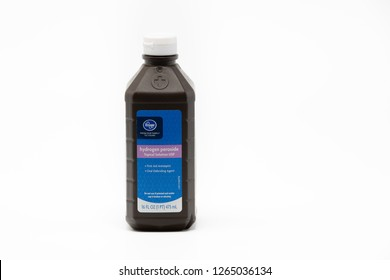 Portland, OR / USA - December 18 2018: Hydrogen peroxide topical solution made by Kroger company, isolated on white background. Used as first aid antiseptic.