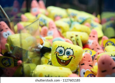 Portland, OR / USA - July 4 2018: Contents of the claw machine in the Oaks amusement park. Spongebob squarepants and Patrick the star plush toys