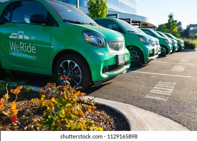 Portland, OR / USA - July 8 2018: Row of electric green e-rides cars at Daimler for sharing among employees in emergency situations.