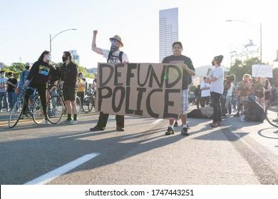 "Portland, OR / USA - June 1 2020: Demonstrators with ""Defund Police"" banner on a Morrison bridge during George Floyd killing protest"