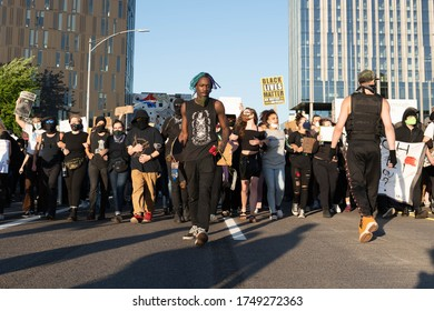 Portland, OR / USA - June 1 2020: African American youth at the front of the protester crowd during George Floyd killing demonstration on a Morrison bridge.