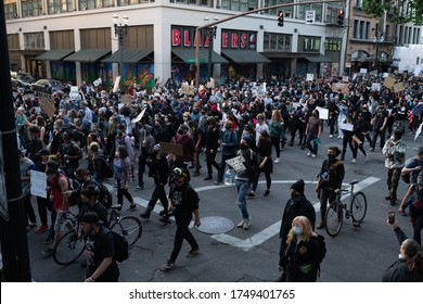 Portland, OR / USA - June 1 2020: Large crowd of young protesters in downtown George Floyd killing demonstration.