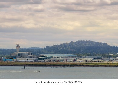 Portland, OR / USA - June 2019: View of concourse D and E with Air Traffic Control (ATC) tower at Portland International Airport (PDX)