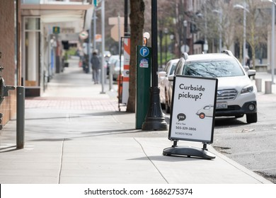 Portland, OR / USA - March 22 2020: Nordstrom curbside pickup banner outside of the mall during coronavirus pandemic lockdown.