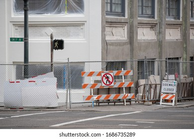 Portland, OR / USA - March 22 2020: Construction site closed down with signs and road barricades placed on the street.