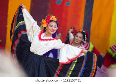 Portland, OR / USA - May 7 2016: Beautiful woman in a traditional latino costume dancing at the cinco de mayo celebration.