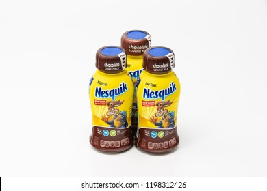 Portland, OR / USA - October 8 2018: Three Nesquik by Nestle company chocolate milk bottles with drink for kids on light background