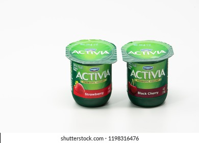 Portland, OR / USA - October 8 2018: Two Activia Dannon probiotic yogurts in green plastic cups.