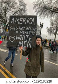 A Portland, OR woman protests Donald Trump in the 2016 Women's March.