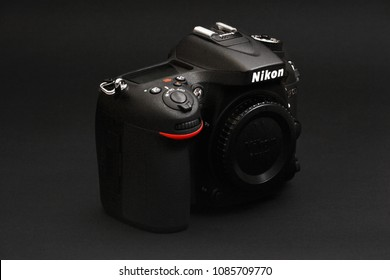 Port-Louis, Mauritius - April 12, 2018: Nikon D7100 digital single lens reflex camera, on a dark background. Nikon is a Japanese multinational corporation specializing in optics and imaging products.