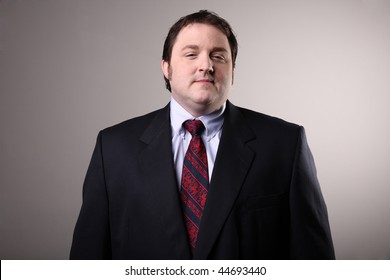 Portly man wearing a suit.