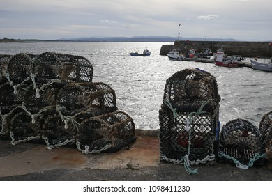 PORTMAHOMACK, SCOTLAND, UK - May 19, 2018: An inshore fishing boat returns with it's catch to the harbour at Portmahomack Scotland UK