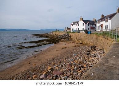 PORTMAHOMACK, SCOTLAND, UK - May 19, 2018: General view of the sea wall and traditional houses at Portmahomack Scotland UK