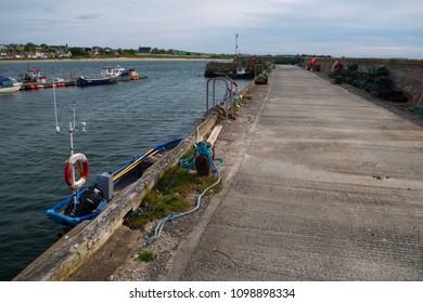 PORTMAHOMACK, SCOTLAND, UK - May 19, 2018: General view of the harbour in the fishing village of Portmahomack, Scotland, UK