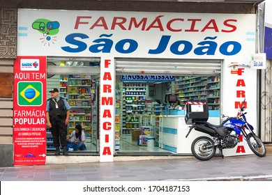 Porto Alegre / Brazil - April 04 2020: Pharmacy Sao Joao in with medicine delivery moto in front. Service in use during quarantine due to Coronavirus / COVID-19. Popular Pharmacy Program.