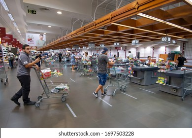 Porto Alegre / Brazil - March 26 2020: Social distancing in in supermarket line at Bourbon Zaffari Ipiranga buying due to coronavirus outbreak. Ground markers with distance in the queue of market.