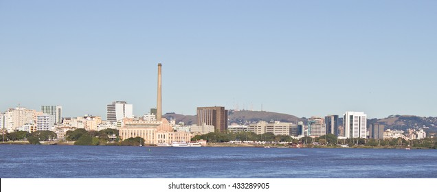 Porto Alegre port. Downtown buildings and blue sky are shown too. Gasometro tower completes the image.