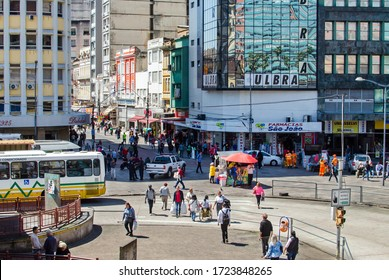Porto Alegre / Rio Grande do Sul / Brasil - March 12, 2020: People walking on the street among buildings in the city of Porto Alegre, southern Brazil