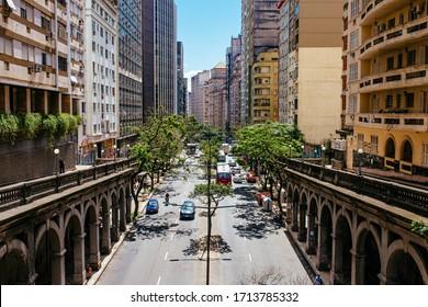 PORTO ALEGRE, RS/BRAZIL - MARCH 19th, 2019: Cityscape over the Otávio Rocha bridge by Borges Medeiros avenue at Porto Alegre's downtown, Capital of Rio Grande do Sul, State of Brazil in the afternoon.