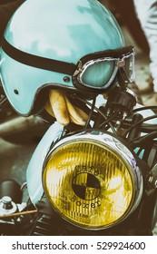 Porto Cervo Italy - sardinia, 2016 : OLD classic motorcycle vintage, Old shabby motorcycle helmets. Obsolete helmets cracks