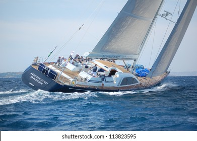 PORTO CERVO, ITALY - SEPTEMBER 12: team yacht highland breeze compete in the Rolex Swan Cup boat race on September 12, 2012 in Porto Cervo, Italy.