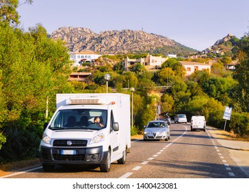 Porto Cervo, Italy - September 8, 2017: Rv cavaran and cars on the road in Costa Smeralda on Sardinia Island in Italy in summer. Motorhome rving on motorway. Camper trailer on highway.